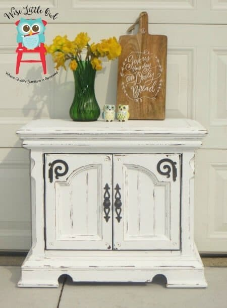 Farmhouse finish end table with swirly hardware
