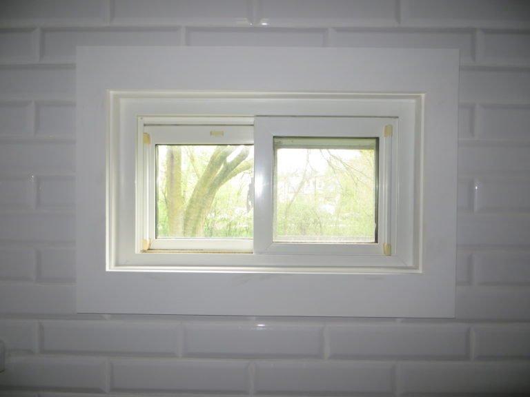 framed window in tub area